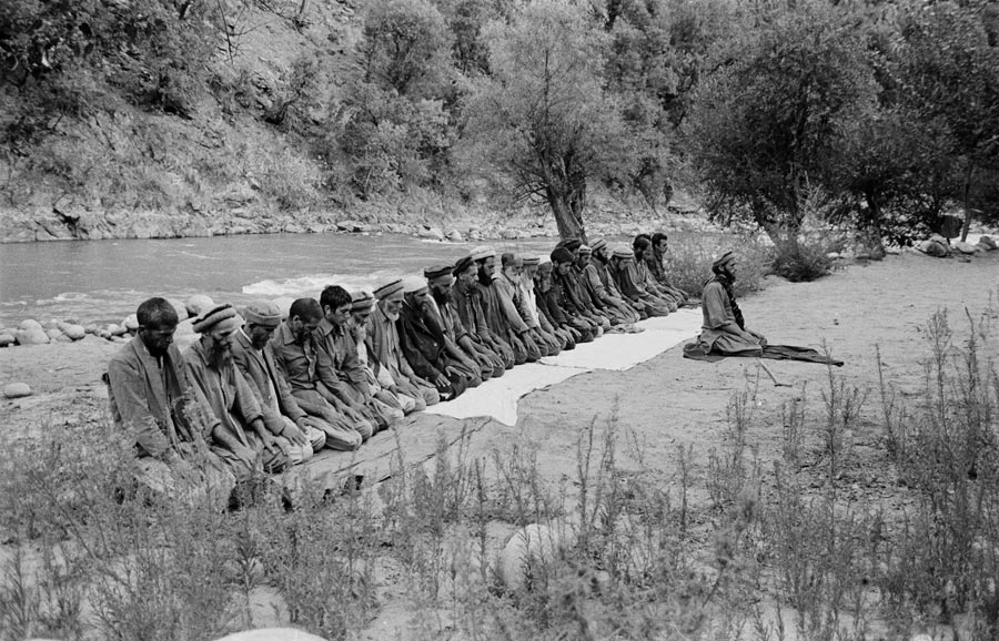 Praying along the Kunar River