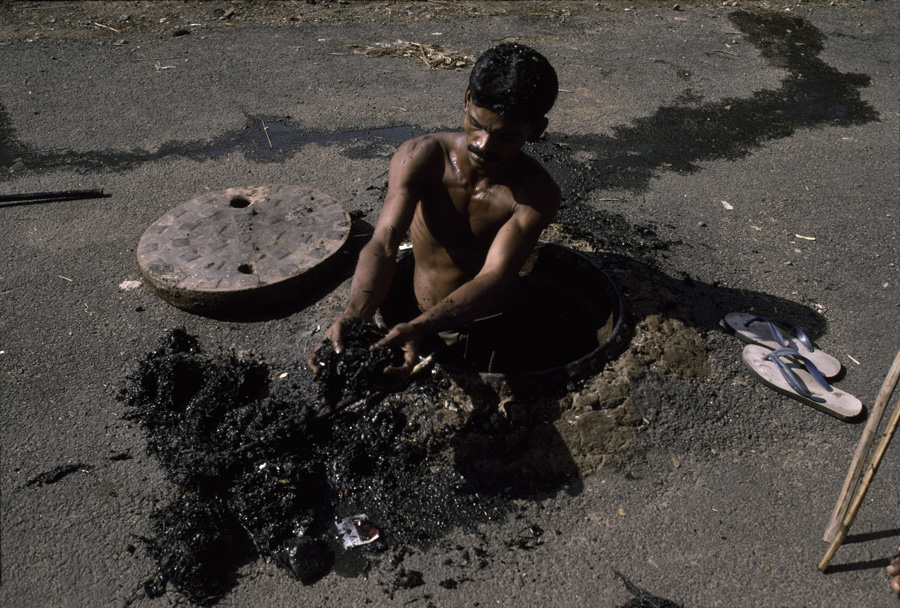 Man working in Sewer, India
